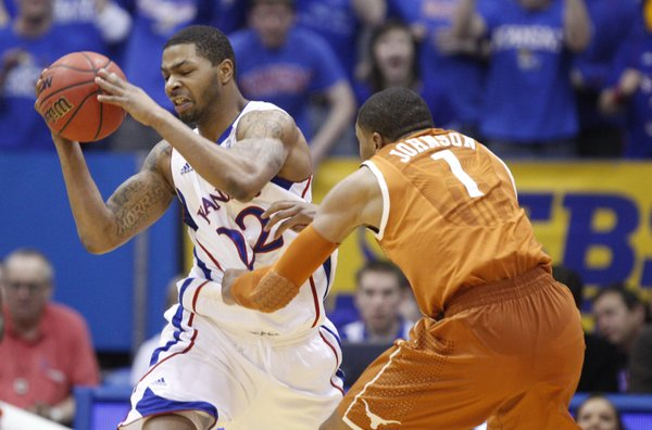Kansas forward Marcus Morris pulls a steal from Texas guard Gary Johnson during the first half on Saturday, Jan. 22, 2011 at Allen Fieldhouse.