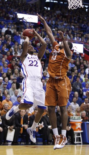 Kansas forward Marcus Morris hangs for a shot over Texas forward Tristan Thompson during the first half on Saturday, Jan. 22, 2011 at Allen Fieldhouse.