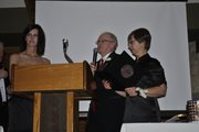 "Don ""Red Dog"" Gardner and his wife, Bev, right, accept a presidential award Saturday night for their dedication to fitness and physical activity through Red Dog's Dog Days workouts. Red Dog was the guest of honor in a roast held at Alvamar Country Club."