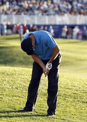 Former Kansas University golfer Gary Woodland reacts after missing his eagle chip on the 18th hole of the Palmer Private course at PGA West during the final round of the Bob Hope Classic on Sunday in La Quinta, Calif. Woodland forced a playoff, which Jhonattan Vegas won on the second hole.