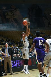 Colorado senior guard Cory Higgins shoots during a game at the Coors Events Center in Boulder, Colo. Higgins averages 16.1 points a game for the Buffaloes.