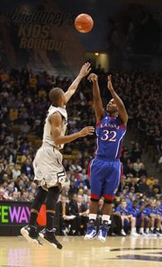 Kansas guard Josh Selby hoists a three-pointer over Colorado guard Cory Higgins during the first half on Tuesday, Jan. 25, 2011 at the Coors Events Center in Boulder.