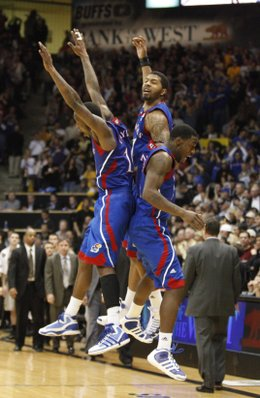 Kansas players Tyshawn Taylor, left, Markieff Morris, center, and Elijah Johnson come together for a flying, celebratory bump following the Jayhawks' 82-78 win over Colorado on Tuesday, Jan. 25, 2011 at the Coors Events Center in Boulder.