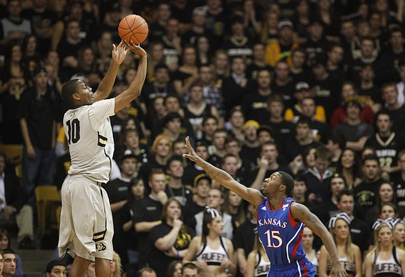 Colorado guard Alec Burks pulls up for a three-pointer over Kansas guard Elijah Johnson during the first half on Tuesday, Jan. 25, 2011 at the Coors Events Center in Boulder.