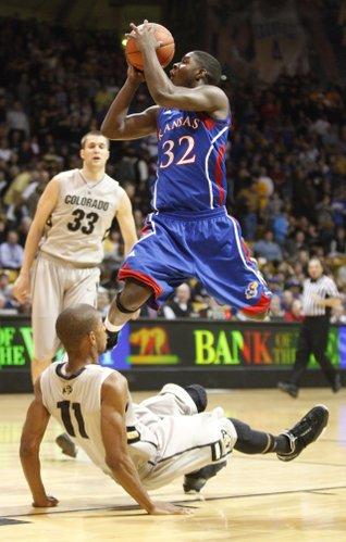Kansas guard Josh Selby runs over Colorado guard Cory Higgins on a drive in the first half on Tuesday, Jan. 25, 2011 at the Coors Events Center in Boulder. Selby was called for a charge on the play.
