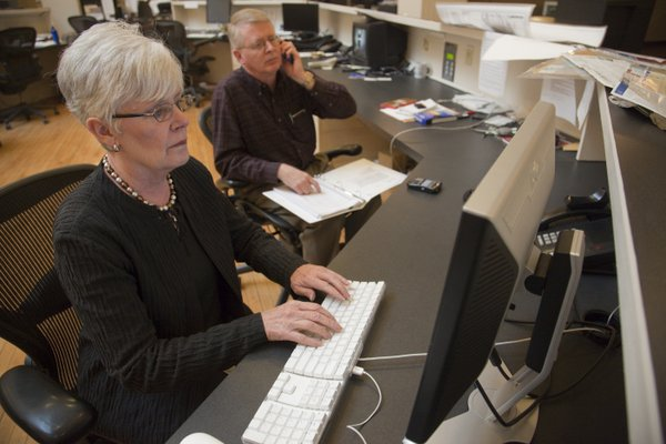 Kansas Insurance Commisioner Sandy Praeger, left, participates in an online chat Wednesday, Jan. 26, 2011, in The News Center while public information officer Bob Hanson is on the phone. Praeger will be answering questions about insurance and health reform during another chat Aug. 1.