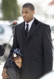 Kansas basketball player Thomas Robinson and his 9-year-old sister Jayla Robinson, arrive for funeral services of their mother Lisa Robinson, Thursday, Jan. 27, 2011, at Antioch Baptist Church in Washington.