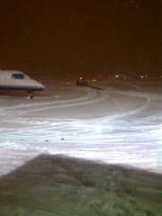 Wayne Simien tweeted this photo of a snow-covered runway in Washington D.C. on Wednesday, Jan. 26, 2011. Simien said his plane was stuck on the runway.