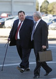 Former University of Kansas athletic department consultant, Thomas Ray Blubaugh, left, and his attorney Steve Robison arrive at the U.S. Federal Courthouse, in Wichita, Kan., on Friday, Jan. 28, 2011, to plead guilty on a charge of conspiring to commit wire fraud. Prosecutors say he, along with others, are charged with stealing athletic tickets and scalping them for cash to ticket brokers and third parties outside the university totally $5 million.