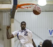 Bishop Seabury freshman Khadre Lane dunks during Bishop Seaburys game against Veritas Christian School on Friday, Jan. 28, 2011 in Lawrence. The Seabury boys won, 56-28.