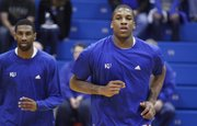 Kansas forward Thomas Robinson, right, runs through warm-up drills next to teammate Justin Wesley prior to tipoff against Kansas State on Saturday, Jan. 29, 2011 at Allen Fieldhouse.