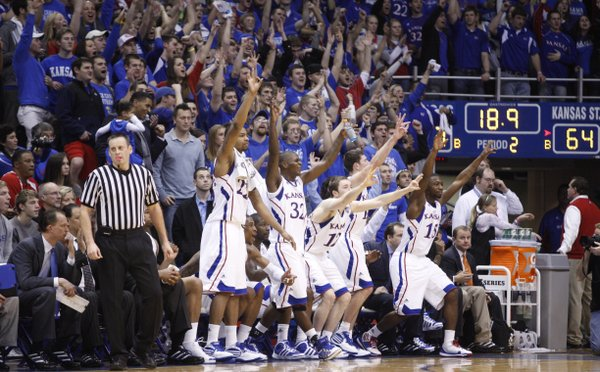 The Kansas bench celebrates a three-pointer from Jordan Juenemann against Kansas State with seconds remaining in the second half on Saturday, Jan. 29, 2011 at Allen Fieldhouse.