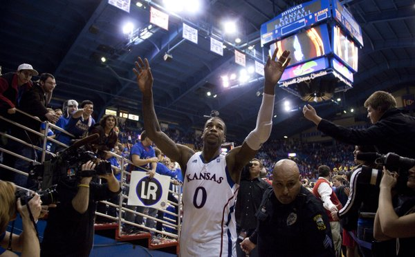 Kansas forward Thomas Robinson waves to the Fieldhouse crowd as he leaves following the Jayhawks' 90-66 win over Kansas State on Saturday, Jan. 29, 2011 at Allen Fieldhouse. Robinson erupted for 17 points to help lead the effort just two days after the funeral for his mother Lisa Robinson.