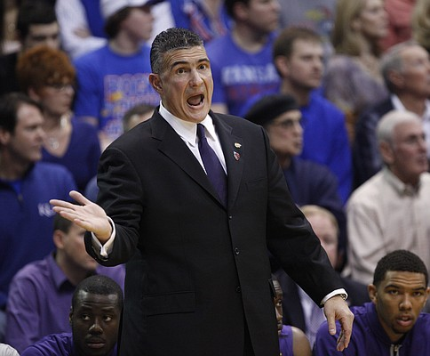 Kansas State head coach Frank Martin protests a call with an official during the first half on Saturday, Jan. 29, 2011 at Allen Fieldhouse.