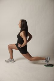 Sliding reverse lunge, step two: Extend the leg on the slider back into a lunge position. Slide back up into place. Do the desired amount of reps on one leg and then switch to the other side. It's important to keep your front knee from going past your toe while you lunge