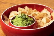 Green peas and cilantro add some extra green kick to this lower fat guacamole.