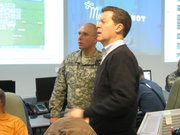 Kansas Adjutant General Lee Tafanelli and Gov. Sam Brownback on Tuesday survey weather reports from the State Emergency Operations Center in Topeka. 
