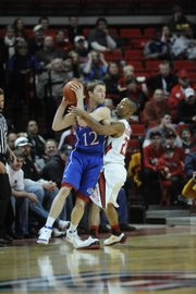 Texas Tech guard John Roberson defends Kansas guard Brady Morningstar in the first half Tuesday, Feb. 1, 2011 in Lubbock, Texas.