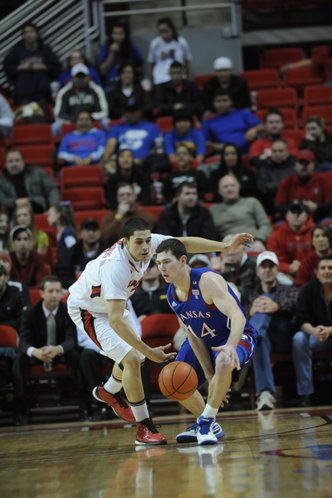 Kansas guard Tyrel Reed dribbles against Texas Tech on Tuesday, Feb. 1, 2011 in Lubbock, Texas.