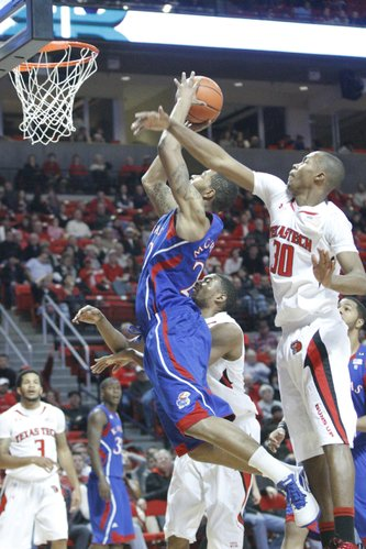 Kansas forward Marcus Morris skies for two points over Texas Tech's Jaye Crockett on Tuesday, Feb. 1, 2011 in Lubbock, Texas.