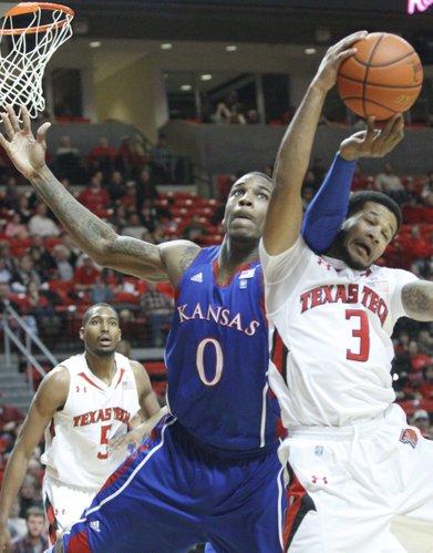 Kansas forward Thomas Robinson fights for a rebound with Texas Tech's Javarez Willis on Tuesday, Feb. 1, 2011 in Lubbock, Texas.