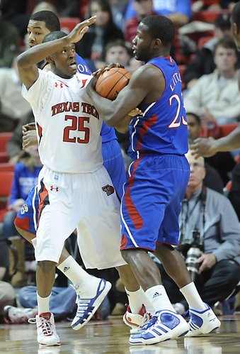 Kansas guard Mario Little fights for the ball with Texas Tech's David Tairu on Tuesday, Feb. 1, 2011 in Lubbock, Texas.
