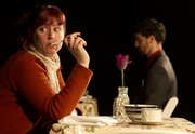 """Kitty Steffens, Lawrence, plays Jean the female protagonist in """"Dead Man&squot;s Cell Phone,"""" a written by Sarah Ruhl.  Doogin Brown, Kansas City, Mo., plays the titular dead man. """"It's a very beautiful and surreal dark comedy,"""" Steffens says."""