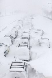 Hundreds of cars are seen stranded Wednesday on Lake Shore Drive in Chicago. A winter blizzard of historic proportions wobbled an otherwise snow-tough Chicago, stranding hundreds of drivers for up to 12 hours overnight on the city's showcase lakeshore thoroughfare and giving many city schoolchildren their first-ever snow day.