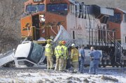 Emergency workers gather at the scene of a fatal accident involving a BNSF train and a truck near Lakeview Lake Friday, Feb. 4, 2011.