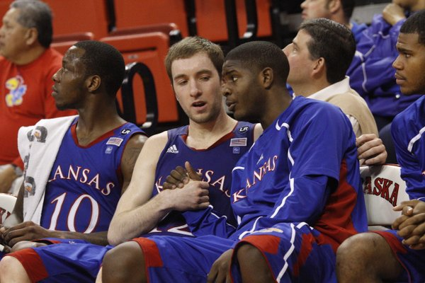 Kansas guard Josh Selby, right, congratulates Brady Morningstar in the second half Saturday, Feb. 5, 2011 at the Devaney Center in Lincoln, Neb.