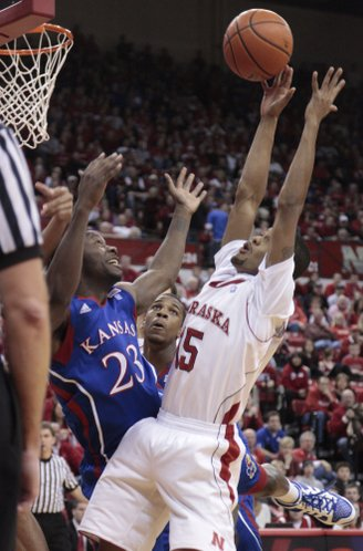 Kansas guard Mario Little collides with Nebraska's Ray Gallegos Saturday, Feb. 5, 2011 at the Devaney Center in Lincoln, Neb.