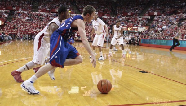 Kansas guard Brady Morningstar drives the baseline around Nebraska's Lance Jeter during the second half Saturday, Feb. 5, 2011 at the Devaney Center in Lincoln, Neb.