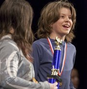 Seth Peters of Raintree Montessori smiles after placing second in the Douglas County Spelling Bee Saturday at Southwest Junior High School.