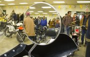 Motorcycle enthusiasts fill Building 21 at the Douglas County Fairgrounds to see dozens of vintages motorcycles on display at the Santa Fe Trail Vintage Motorcycle Show and Swap Meet Sunday, Feb. 6, 2011.