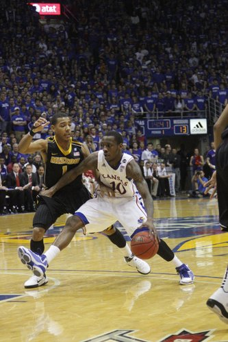 Kansas guard Tyshwan Taylor drives against Missouri's Phil Pressey on Monday, Feb. 7th, 2011 at Allen Fieldhouse.