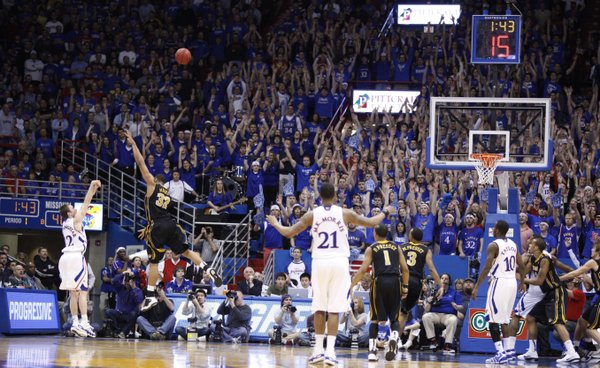 Kansas guard Brady Morningstar connects on a three-pointer from the corner over Missouri forward Steve Moore during the first half on Monday, Feb. 7, 2011 at Allen Fieldhouse.