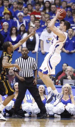Kansas guard Tyrel Reed pulls up for a shot over Missouri guard Marcus Denmon during the first half on Monday, Feb. 7, 2011 at Allen Fieldhouse.