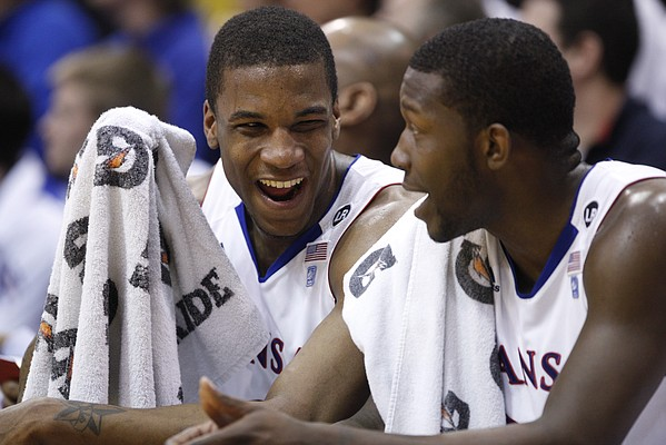 Kansas teammates Thomas Robinson, left, and Mario Little laugh on the bench late in the second half against Missouri on Monday, Feb. 7, 2011 at Allen Fieldhouse.