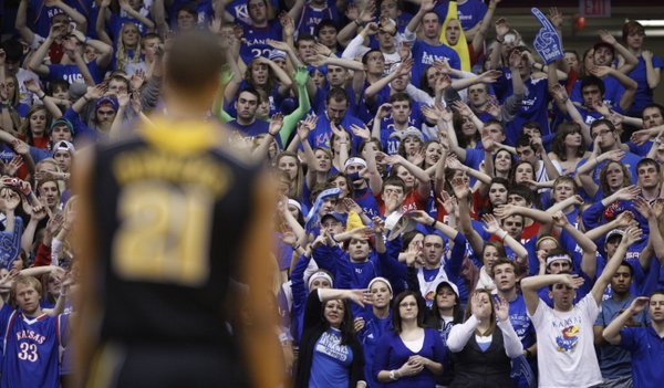 The Kansas student section waves the wheat as Missouri forward Laurence Bowers walks to the bench after fouling out in the second half on Monday, Feb. 7, 2011 at Allen Fieldhouse.