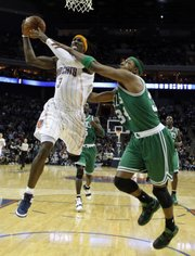 Boston's Paul Pierce fouls Charlotte's Gerald Wallace (3). The Bobcats defeated the Celtics, 94-89, on Monday, Feb. 7, 2011 in Charlotte, N.C.