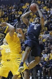 Pitt's Gilbert Brown (5) shoots over West Virginia's Kevin Jones. Pittsburgh won, 71-66, Monday, Feb. 7, 2011 in Morgantown, W.Va.