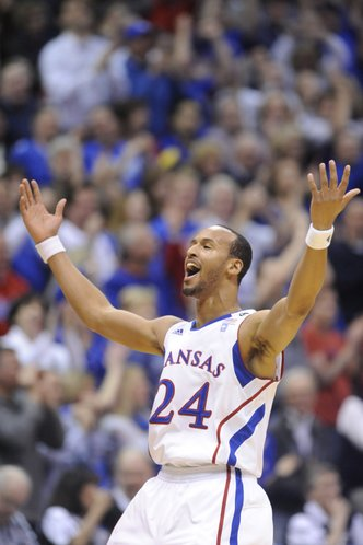 Kansas guard Travis Releford gets the crowd to its feet after scoring a basket against Missouri on Monday, February 7, 2011 at Allen Fieldhouse.