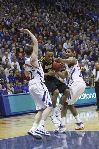 Kansas players Brady Morningstar (12) and Marcus Morris (22) defend Missouri's Phil Pressey on Monday, February 7, 2011 at Allen Fieldhouse.