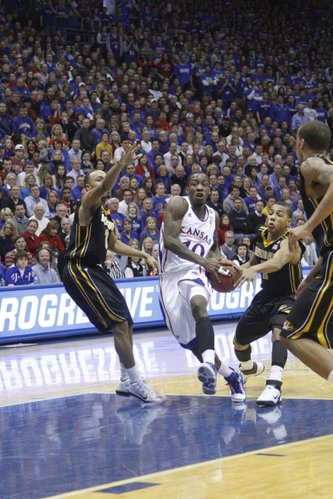 Kansas guard Tyshawn Taylor drives through the lane against the Missouri defense in the first half on Monday February 7, 2011 at Allen Fieldhouse.