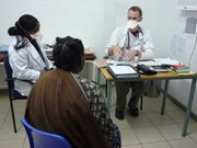 Lawrence native Mark Stover speaks with a tuberculosis patient in Sudan. Stover spend half of 2010 in Sudan with Doctors Without Borders, and the other half in Mongolia under the program. To the left is Stover's translator.
