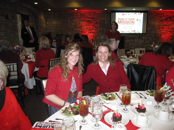 Ali Edwards, of the Leo Center, left, and Cindy Hart, of Bert Nash Community Mental Health Center, attend the Go Red For Women luncheon on Friday, Feb. 11, 2011, at The Oread Hotel.