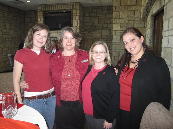 From left are Sarah Anderton, Lawrence, Megan Richardson, Lawrence, Kristy Wit, Tonganoxie, and Doré Jones, Lecompton. They attended the Go Red For Women luncheon Friday, Feb.11, 2011, at The Oread Hotel.