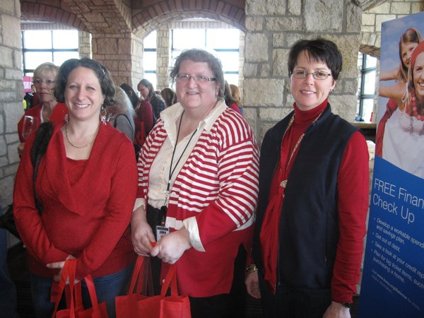 From left Canan Aker, pat Rice and Lezli Root, of Black Hills Energy, attend the Go Red For Women Luncheon & Expo on Friday, Feb. 11, 2011, at The Oread Hotel. The event was a fundraiser for the American Heart Association.