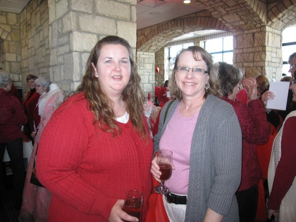 Debbie Liakos, left, and Karen Henley, both of Lawrence, attend the annual Go Red For Women luncheon on Friday, Feb. 11, 2011.