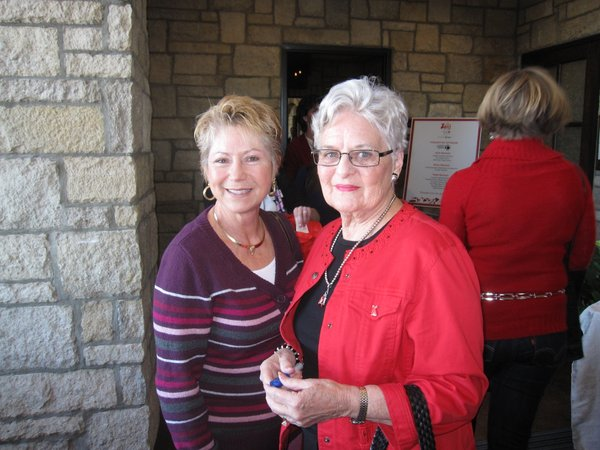Barbara Lowenthal, left and Jeri Busch, both of Lawrence, attend the Go Red For Women luncheon at The  Oread Hotel.